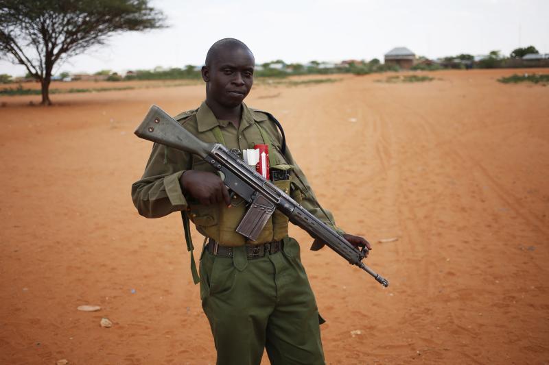 A Kenyan policeman holds his rifle at Kenya-Somalia border near the town of Mandera December 5, 2014.