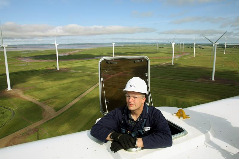 Sprott Power Corporation's Wind Asset Manager Peder Schlanbusch looks out from on top one of the 15 wind turbines which were officially opened in Amherst, Nova Scotia, June 25, 2012.