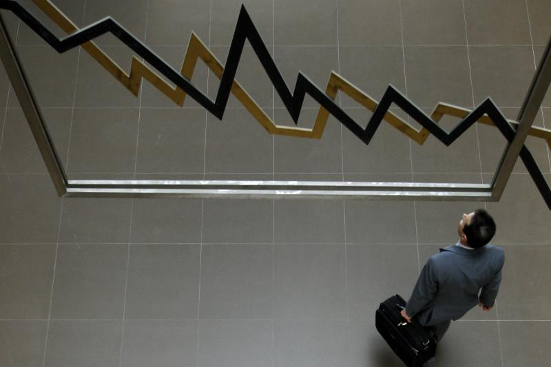 A man walks inside the Athens' stock exchange in Athens, April 28, 2010.