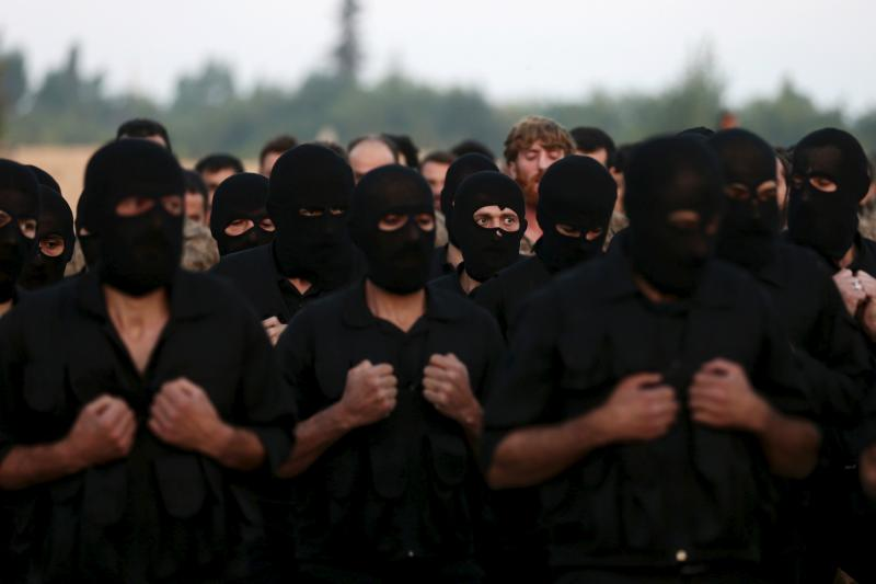 Rebel fighters take part in a military display as part of a graduation ceremony at a camp in eastern al-Ghouta, near Damascus, July 12, 2015.