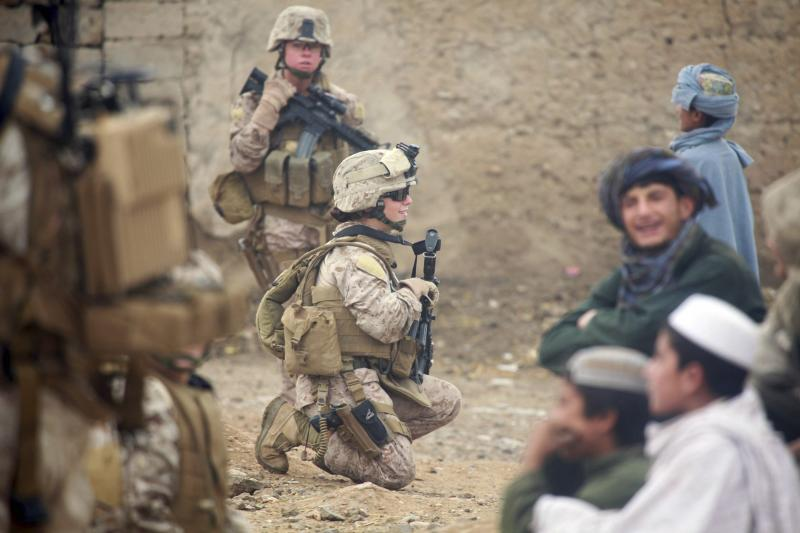 U.S. Marine Corps Lance Cpl. Sienna De Santis and U.S. Navy Petty Officer 3rd Class Heidi Dean on a patrol in Sangin Valley, Afghanistan, October 2010.