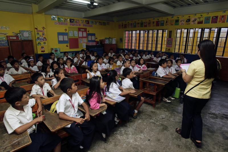Teacher gives lessons in Manila