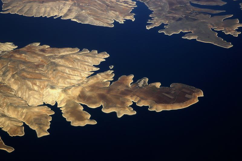 The town of Susuz (C) is seen on the northern shore of the Ataturk dam, November 10, 2014.