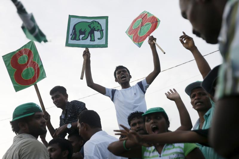 Supporters of Sri Lanka's Prime Minister Ranil Wickramasinghe shout slogans during a rally in Galle, August 14, 2015.
