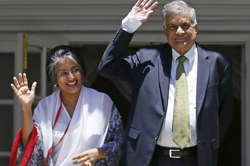 Ranil Wickremesinghe, leader of Sri Lanka's United National Party (UNP), waves next to his wife Maitree Wickremesinghe at the Prime Minister's official residence in Colombo, August 19, 2015.