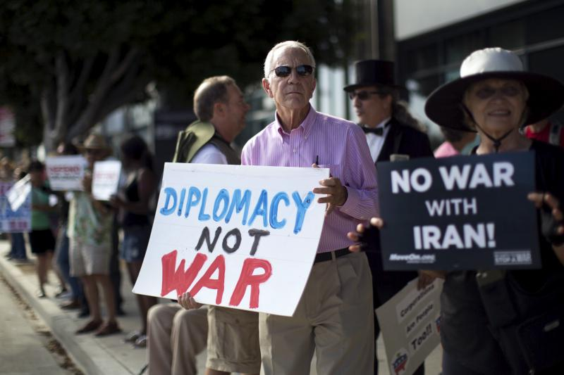 Activist Robin Doyno holds a sign during a rally supporting the current Iran Nuclear Agreement in Los Angeles, California August 26, 2015.