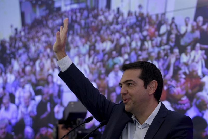Greek former Prime Minister Alexis Tsipras waves during a meeting with members of his Syriza party in Athens, August 29, 2015.