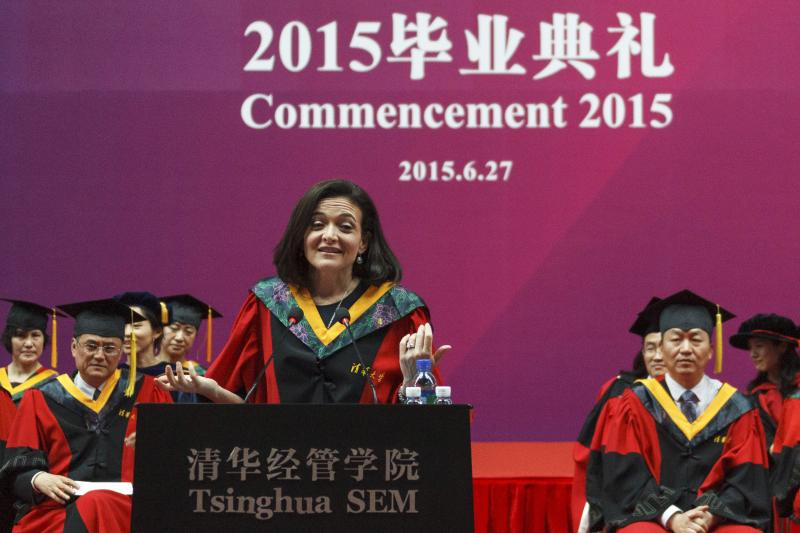Facebook COO Sheryl Sandberg (C) gestures as she gives a commencement speech to the graduate students of the School of Economics and Management at the Tsinghua University in Beijing, China, June 27, 2015.