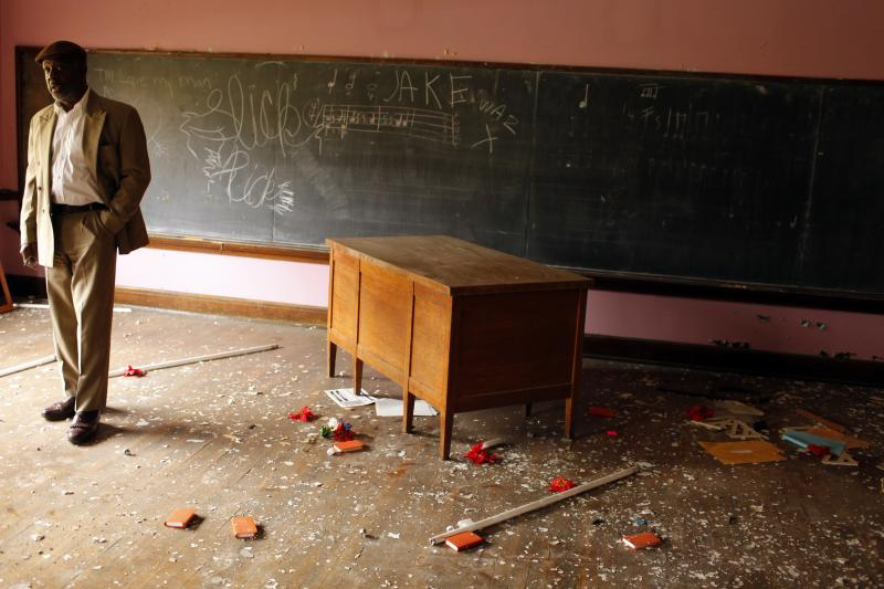 Pastor Charles Hudson stands in a classroom of Madison School, where Hudson worked with the anti-violence organization Bondage Busters, in Youngstown, Ohio November 21, 2009.