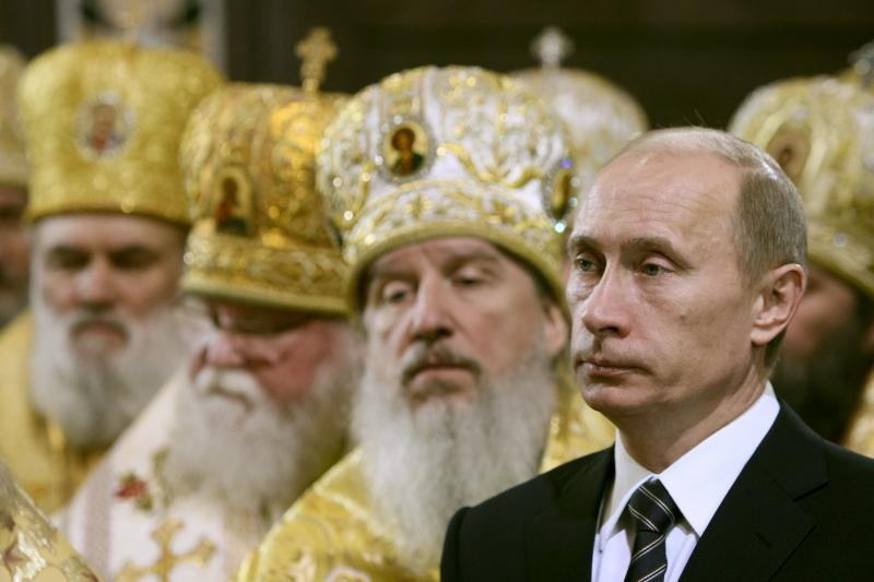 Russian Prime Minister Vladimir Putin attends the crowning ceremony of New Orthodox Patriarch Kirill as the 16th Patriarch of Moscow and all Russia in Moscow's Christ the Saviour Cathedral, February 1, 2009.