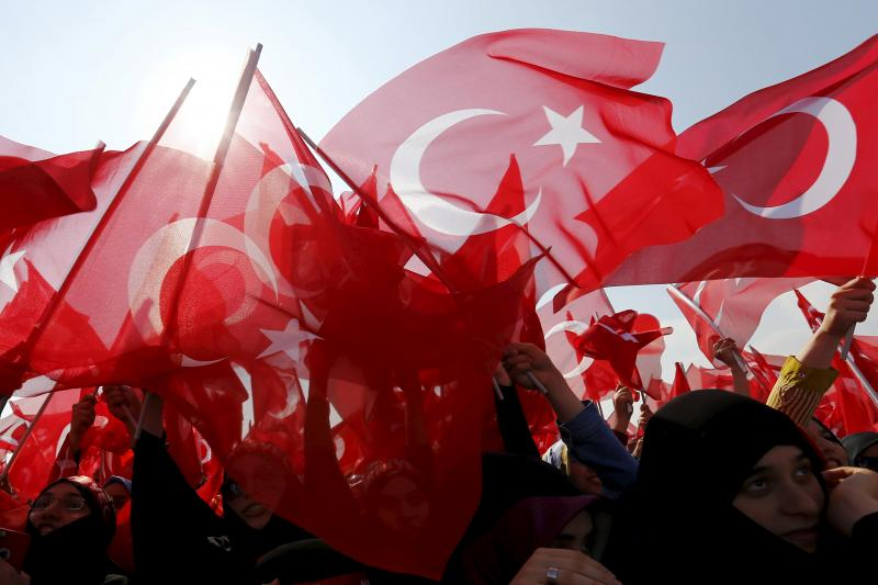 Women wave Turkey's national flags during a rally against recent Kurdish militant attacks on Turkish security forces in Istanbul, Turkey, September 20, 2015.