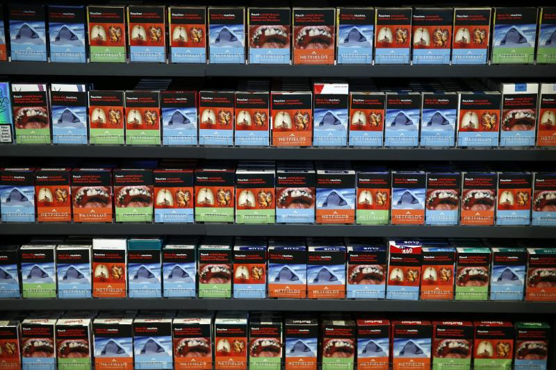 Cigarette boxes with an affixed self-made cigarette label displaying graphic images are pictured in the shop of tobacconist and kiosk owner Janine Schulzki in Berlin February 9, 2013.