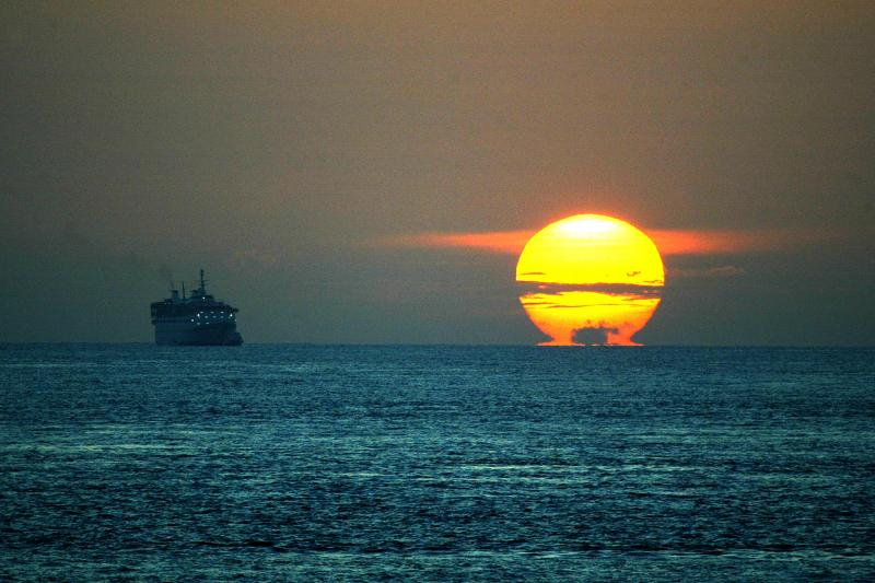 Sunrise over the Straits of Malacca, one of the world's most important shipping lanes, July 20, 2004.