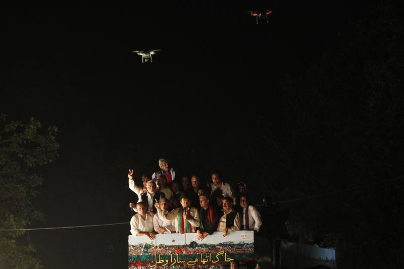 Drones film Imran Khan, chairman of Pakistan Tehreek-e-Insaf, as he addresses to his supporters in Lahore, August 14, 2014.
