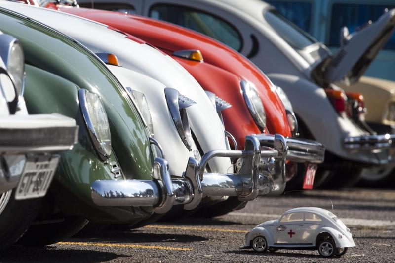 A Volkswagen Beetle toy is seen in front of Beetle cars during celebrations of the National day of the Beetle in Sao Bernardo do Campo, January 23, 2011.
