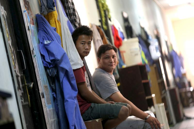 Laborers are pictured in a foreign workers dormitory in the Sanaya Industrial Area in Doha, during a government-guided tour, May 3, 2015.
