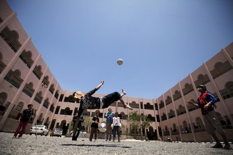Internally displaced people play football in a school in Sanaa May 17, 2015. Residents were forced to leave their homes in the nearby province of Saada amid Saudi-led air strikes.