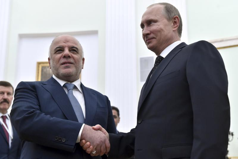 Russian President Vladimir Putin shakes hands with Iraqi Prime Minister Haider al-Abadi during their meeting at the Kremlin in Moscow, May 21, 2015. Moscow and Baghdad are expanding military cooperation, Putin said during talks with al-Abadi.