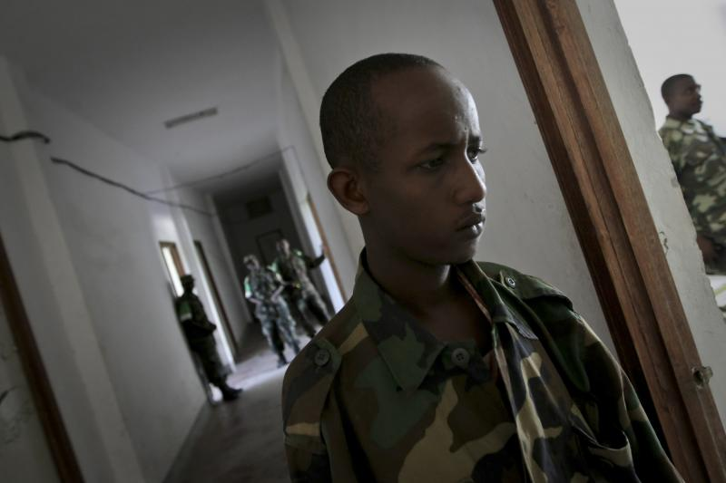 A captured fighter from the Islamist group al Shabab is seen at the headquarters of the African Union Mission in Somalia (AMISOM) in Mogadishu, September 21, 2010. The 24-year-old combatant was captured by AMISOM peacekeepers