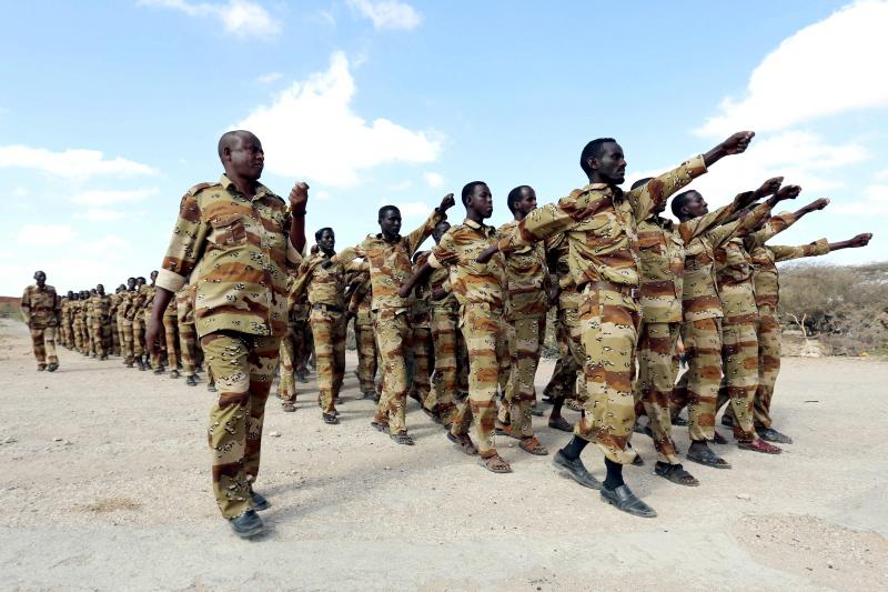 Somalia government soldiers from section 21 take part in a military exercise at their temporary camp in Dusamareeb as they prepare an offensive advance against al Shabaab militants, who have retreated into the central areas of Somalia.