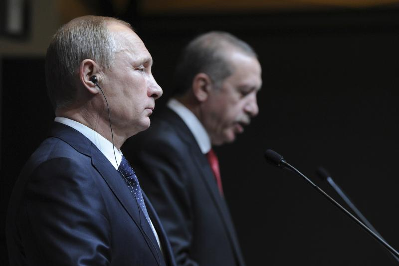 Vladimir Putin in a joint news conference with Recep Tayyip Erdogan in Ankara, December 1, 2014. Putin said that Moscow could not carry on with the South Stream project if the European Union was opposed to it.