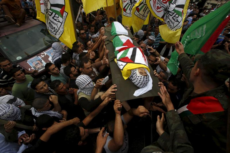 Mourners carry the body of 13-year-old Palestinian boy Abdel-Rahman Abeidallah, who was shot by Israeli troops