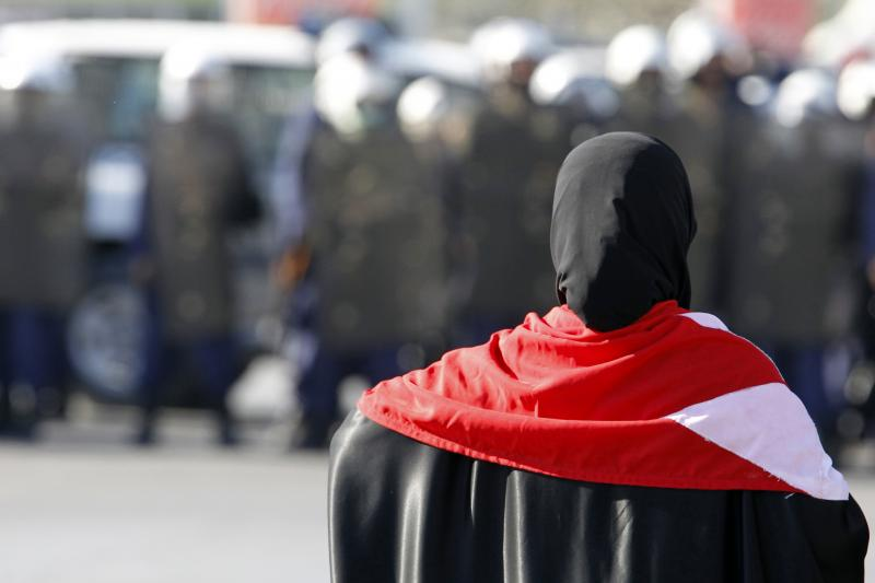 A protester stands in front of riot police in the Bahraini capital of Manama, February 2011. Bahrain has been highly rated on the Heritage Foundations Index of Economic Freedom.