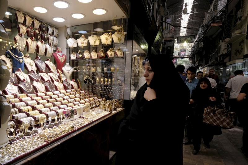 A woman looks at jewelry in a shop at the Grand Bazaar in central Tehran, October 2015. Lifting sanctions will remove a substantial impediment to Iran's economic recovery.