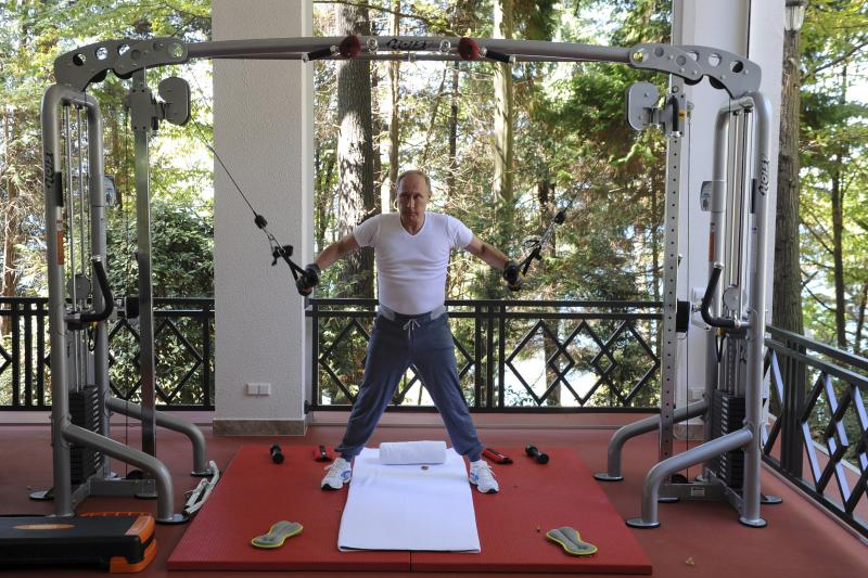 Russian President Vladimir Putin exercises in a gym at the Bocharov Ruchei state residence in Sochi, Russia, August 30, 2015.