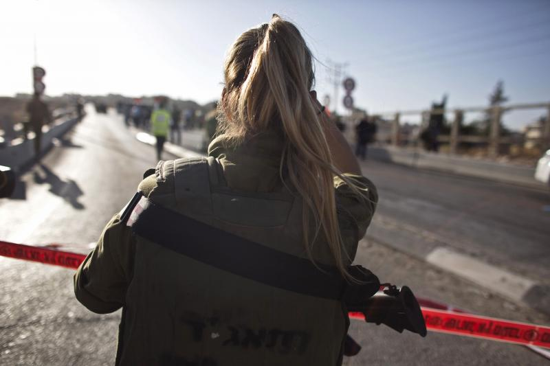 An Israeli soldier looks on at the scene of a stabbing attack in the West Bank Jewish settlement of Adam, north of Jerusalem, October 21, 2015.