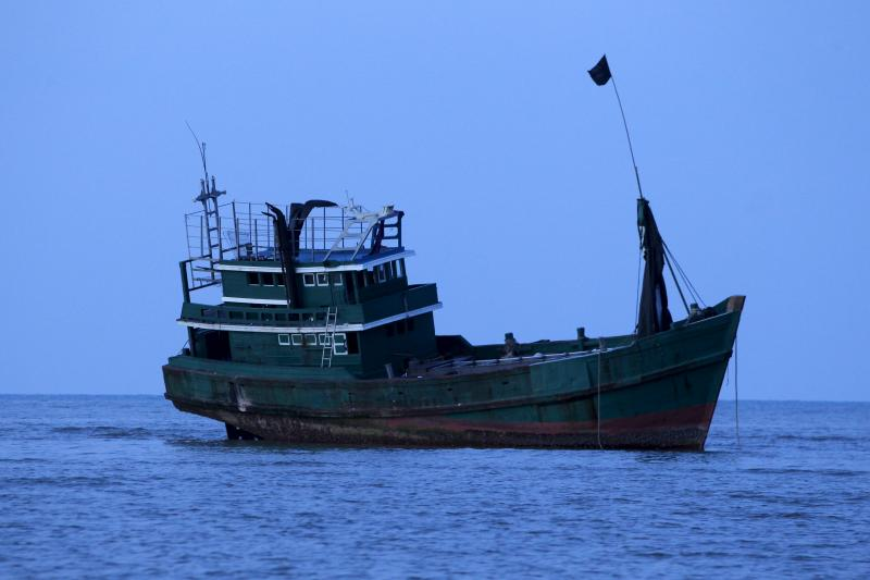 Abandoned boat which carried Rohingya and Bangladeshi migrants from Thailand