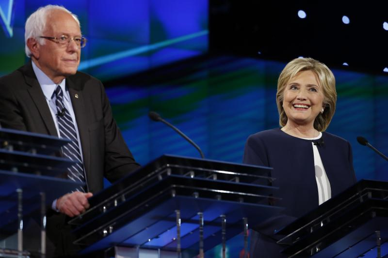 Democratic presidential candidate U.S. Senator Bernie Sanders and former Secretary of State Hillary Clinton smile during the first official Democratic candidates debate of the 2016 presidential campaign in Las Vegas, Nevada October 13, 2015.