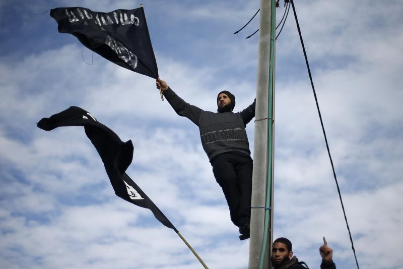 Palestinian Salafists wave flags during a protest in Gaza city, January 19, 2015.