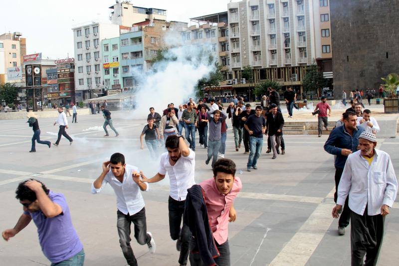 Riot police use tear gas to disperse demonstrators, during a protest against Saturday's bomb blasts in Ankara, in the Kurdish dominated southeastern city of Diyarbakir, Turkey, October 12, 2015.