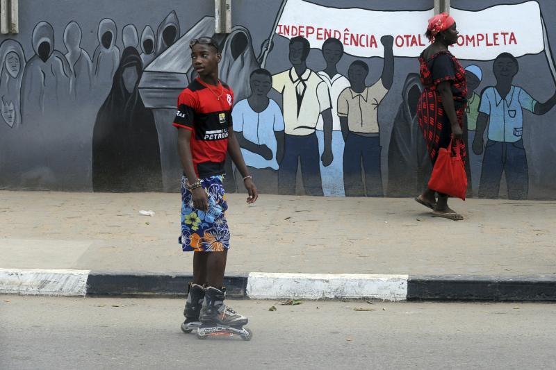 A boy on rollerblades in Luanda, March 2009. . Luanda has increased oil production to the highest levels since 2010, but the increase in output still has not compensated for the loss of income from low prices.