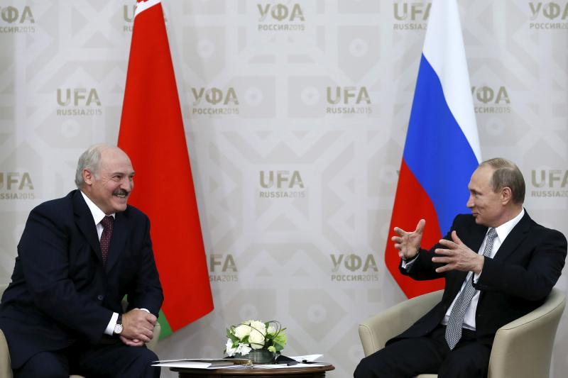 Belarus' Alexander Lukashenko talks with Russian President Vladimir Putin