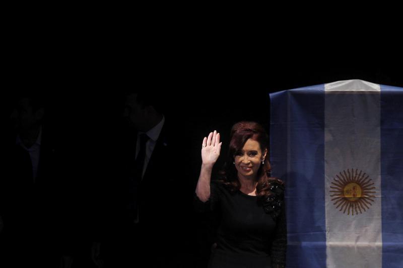 Argentina's outgoing President Cristina Fernandez de Kirchner waves in Buenos Aires