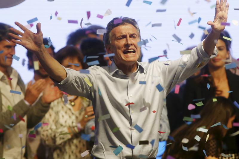 Mauricio Macri waves goodbye to his supporters after the election in Buenos Aires, Argentina