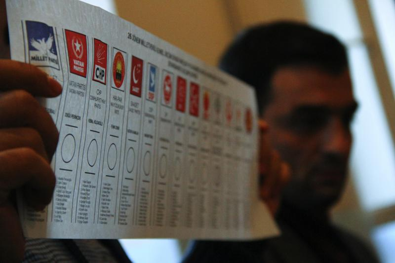 An election official holds a ballot during a count at a polling station in Diyarbakir, Turkey November 1, 2015.