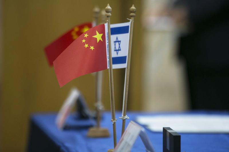 Chinese and Israeli flags are seen on a table during a signing ceremony marking a launch by Tel Aviv University and Beijing's Tsinghua University of a $300 million joint center for innovative research and education, in Tel Aviv, May 20, 2014.