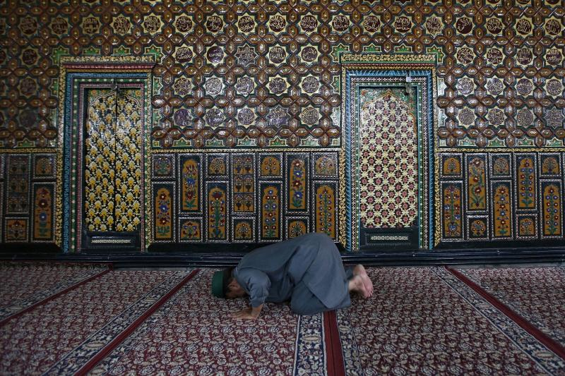 A Kashmiri Muslim man prays at the shrine of Mir Syed Ali Hamdani, a Sufi saint, in Srinagar, India, July 2015. Instead of promoting moderate forms of Islam, policymakers should work with Muslim communities who are committed to fighting terrorism.