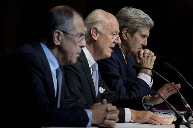 Russian Foreign Minister Sergei Lavrov and US Secretary of State John Kerry (R) listen while UN Special Envoy for Syria Staffan de Mistura speaks during a news conference.