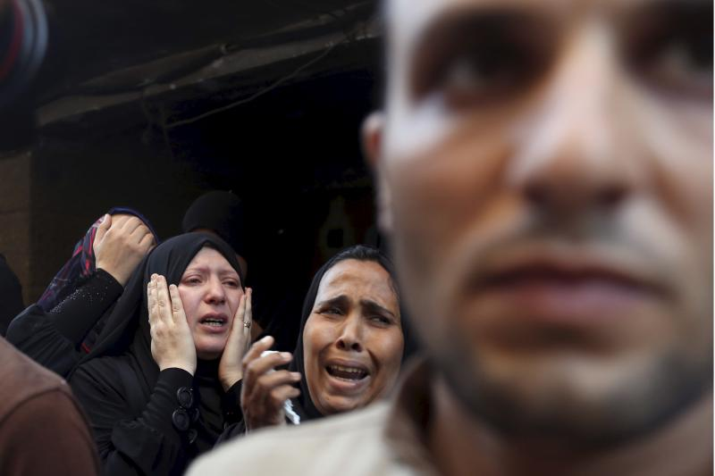 Relatives of an army officers who died in a Sinai attack cry at his funeral near Cairo, Egypt, July 2, 2015.