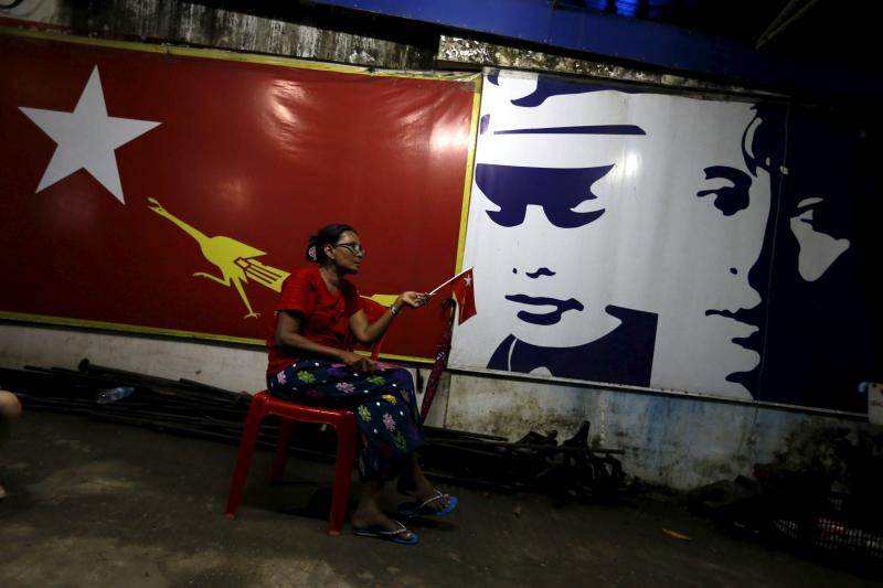 A supporter of Myanmar's pro-democracy figurehead Aung San Suu Kyi sits inside National League for Democracy headquarters (NLD) in Yangon, Myanmar, November 9, 2015.