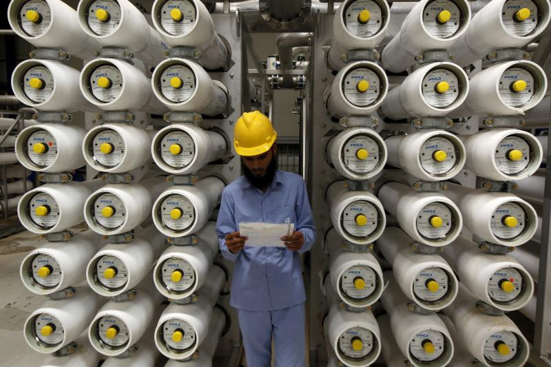 A worker stands at a desalination plant, 35 km south of Riyadh, May 4, 2011.