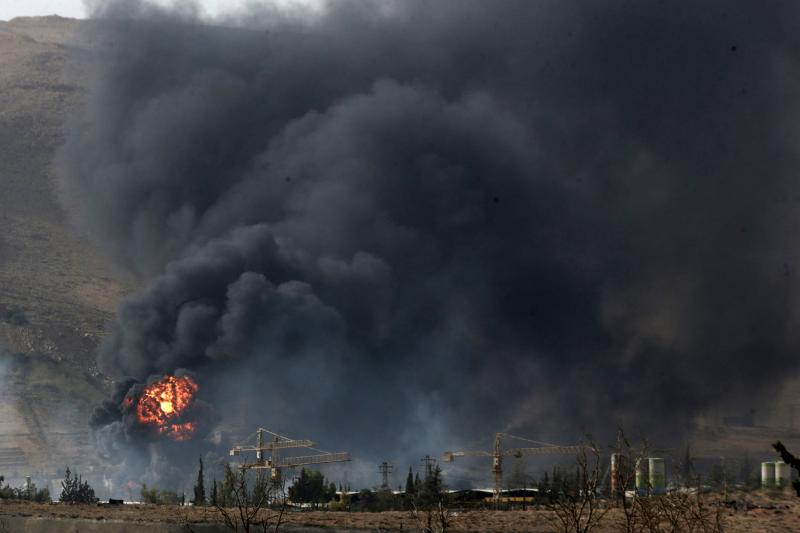 Smoke rises from what activists said was a military position of forces loyal to Syria's President Bashar al-Assad after clashes with Army of Islam fighters, outside Douma, near Damascus September 13, 2015.