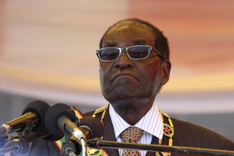 Zimbabwe's President Robert Mugabe waits to address crowds in Harare