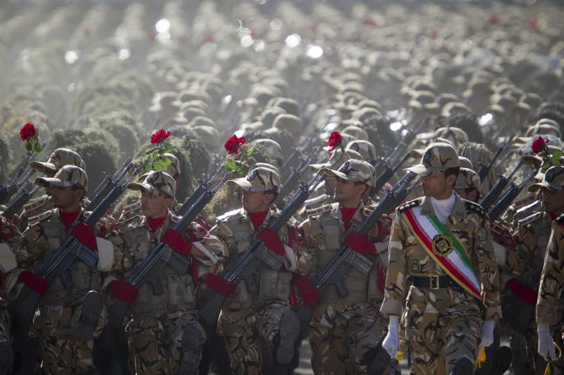 Members of the Iranian army's land force march during a parade to commemorate the anniversary of the Iran-Iraq war (1980-88), in Tehran, September 22, 2010.