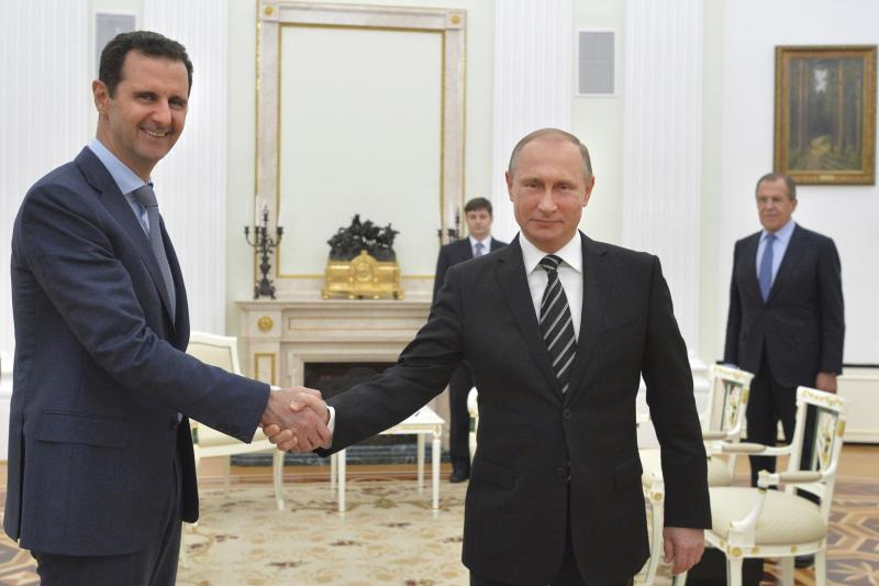 Russian President Vladimir Putin shakes hands with Syrian President Bashar al-Assad during a meeting at the Kremlin in Moscow, October 20, 2015.