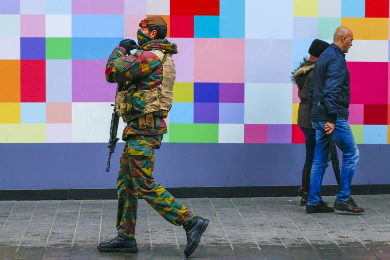A Belgian soldier patrols a shopping street in central Brussels as police search the area during a continued high level of security following the recent deadly Paris attacks, Belgium, November 24, 2015.
